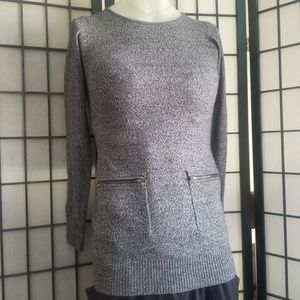 A byer long sleeve sweater with zip pockets